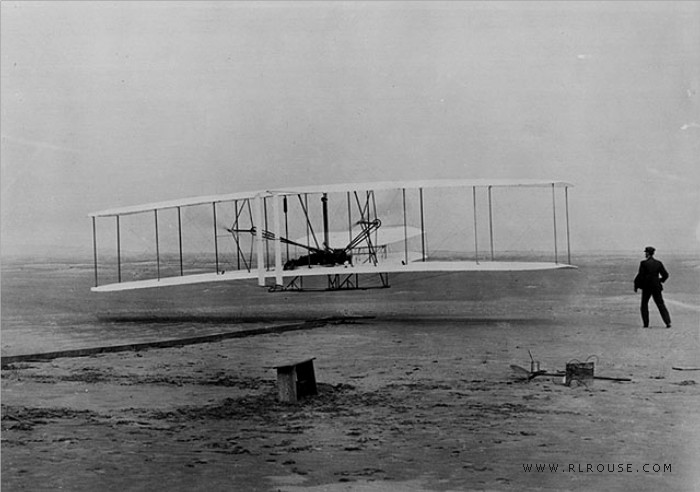 The Wright Brothers making the first airplane flight at Kitty Hawk, NC.
