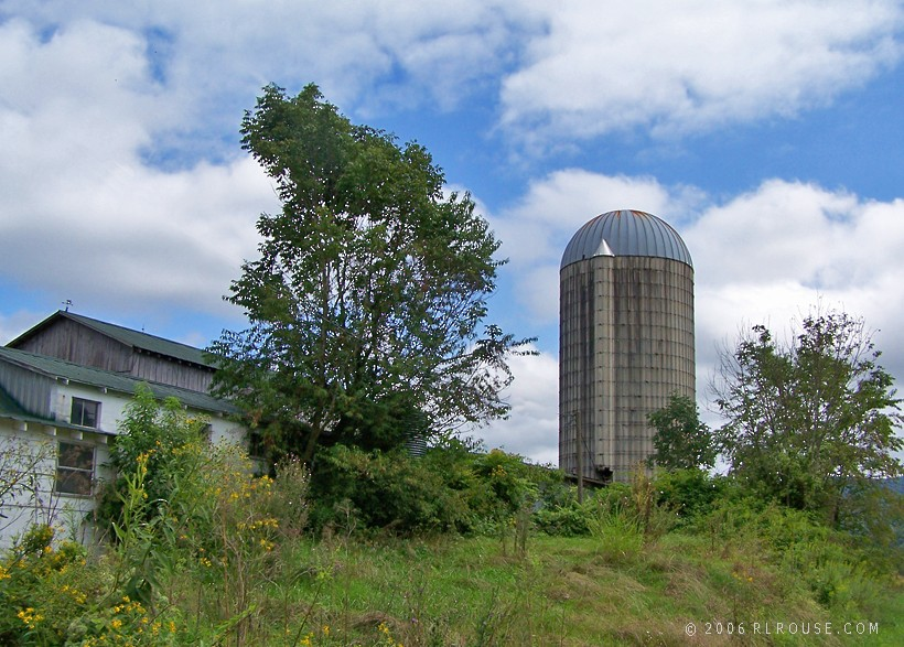 An abandoned milk barn and silo.